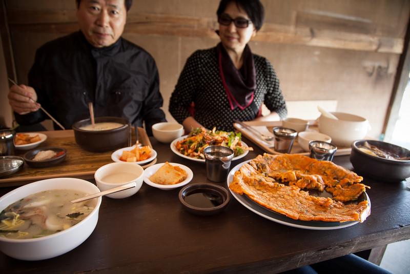 Eating (L-to-R) duk manduguk, seolleongtang, muk, kimchi jeon, and yukgaejang.