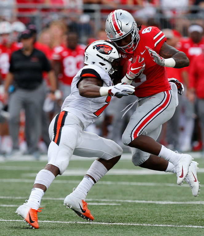 . Oregon State linebacker Kee Whetzel, left, tackles Ohio State running back Brian Snead during the second half of an NCAA college football game Saturday, Sept. 1, 2018, in Columbus, Ohio. Ohio State beat Oregon State 77-31. (AP Photo/Jay LaPrete)