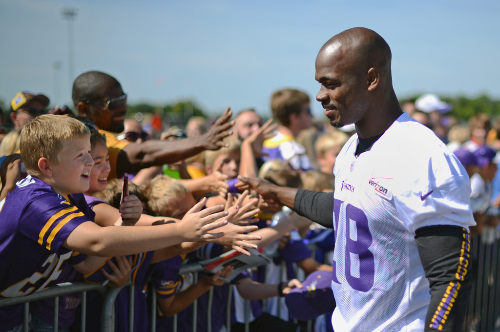 . Vikings running back Adrian Peterson greets a group of ebullient kids on the last day of training camp.  (Pioneer Press: Chris Polydoroff)