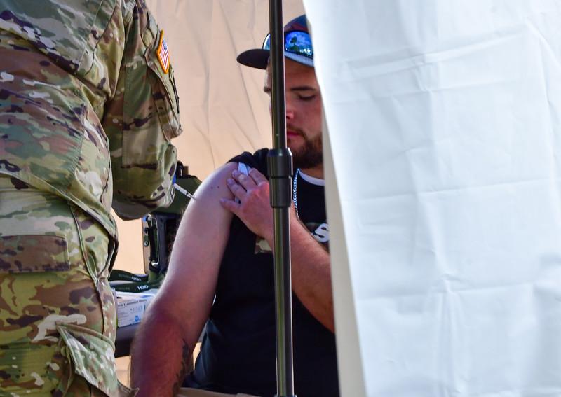 Melissa Schaub-solider giving shot-050821.jpg