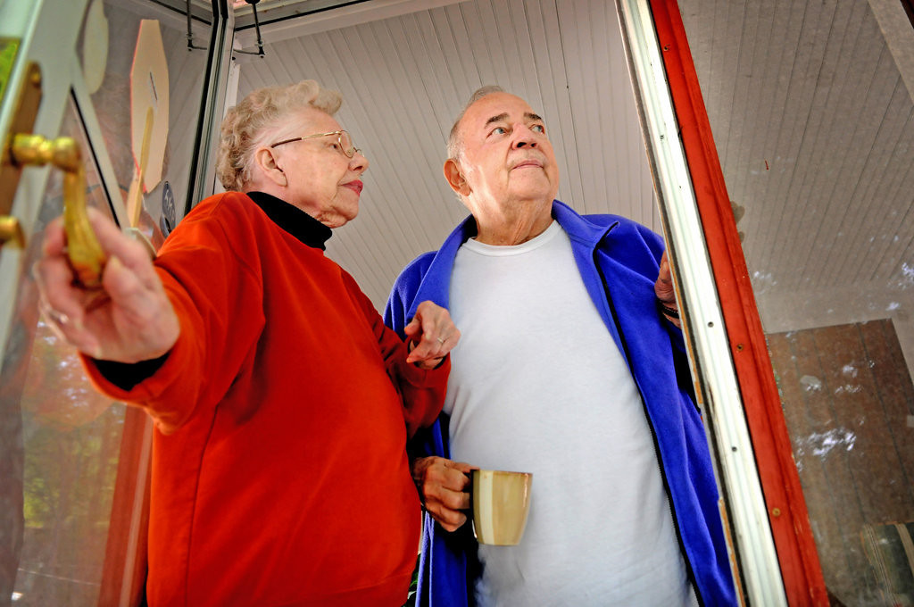 . Opal and Bob Kuehn look out their door as a crew from Jet-Black arrive Wednesday, May 29, 2013, to reseal their driveway for free in St. Paul after scammers shoddily resealed it for thousands of dollars.  (Pioneer Press: Jean Pieri)
