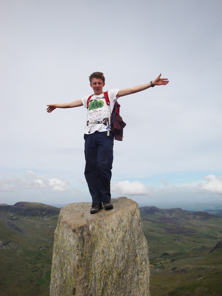 Atop the pinnacle of Tryfan are two even narrower pinnacles named Adam and Eve. The brave can jump between them, but it's a very long fall if misjudged. Andrew T didn't miss and is still with us.
