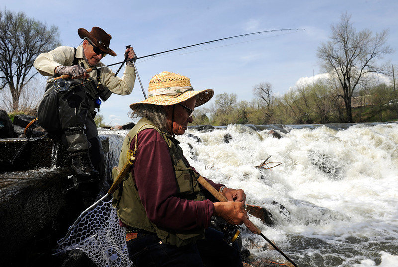 . Urban fishing on Monday, May 13, 2013 along the South Platte River in Denver with John Davenport, left,  and Ronnie Crawford at the falls by Overland Pond Park. (Photo By Cyrus McCrimmon/The Denver Post)