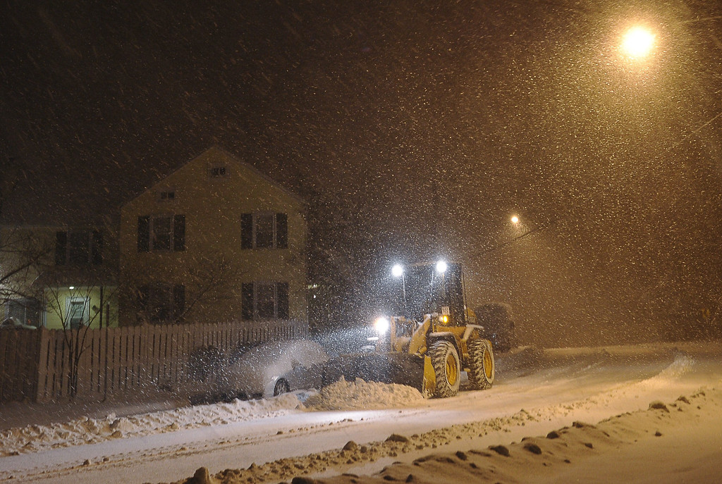 . A snowplow is used to clear a residential street in Chevy Chase, Maryland, in the early hours of February 13, 2014. A deadly ice storm stranded scores of people on slick roads and knocked out power to hundreds of thousands of US homes as winter-weary Americans dug in against Mother Nature\'s latest blow. Accumulation of between 4 to 8 inches, 10 to 20 cm, was expected by the morning. AFP PHOTO / MANDEL NGAN/AFP/Getty Images