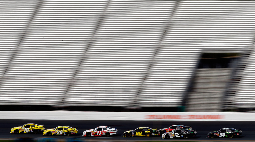 . LOUDON, NH - JULY 13:  Matt Kenseth, driver of the #18 Dollar General Toyota, and Brian Vickers, driver of the #20 Dollar General Toyota, lead the field during the NASCAR Nationwide Series CNBC Prime\'s The Profit 200 at New Hampshire Motor Speedway on July 13, 2013 in Loudon, New Hampshire.  (Photo by Jared Wickerham/Getty Images)