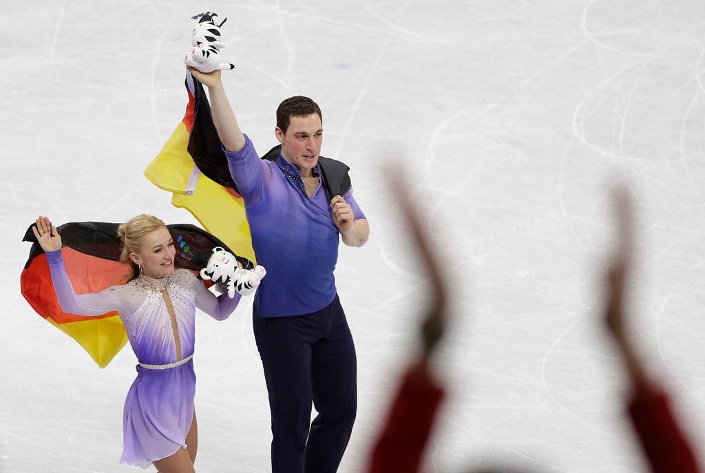 . Aljona Savchenko and Bruno Massot, of Germany, celebrate after winning the gold medal in the pairs free skate figure skating final in the Gangneung Ice Arena at the 2018 Winter Olympics in Gangneung, South Korea, Thursday, Feb. 15, 2018. (AP Photo/David J. Phillip)