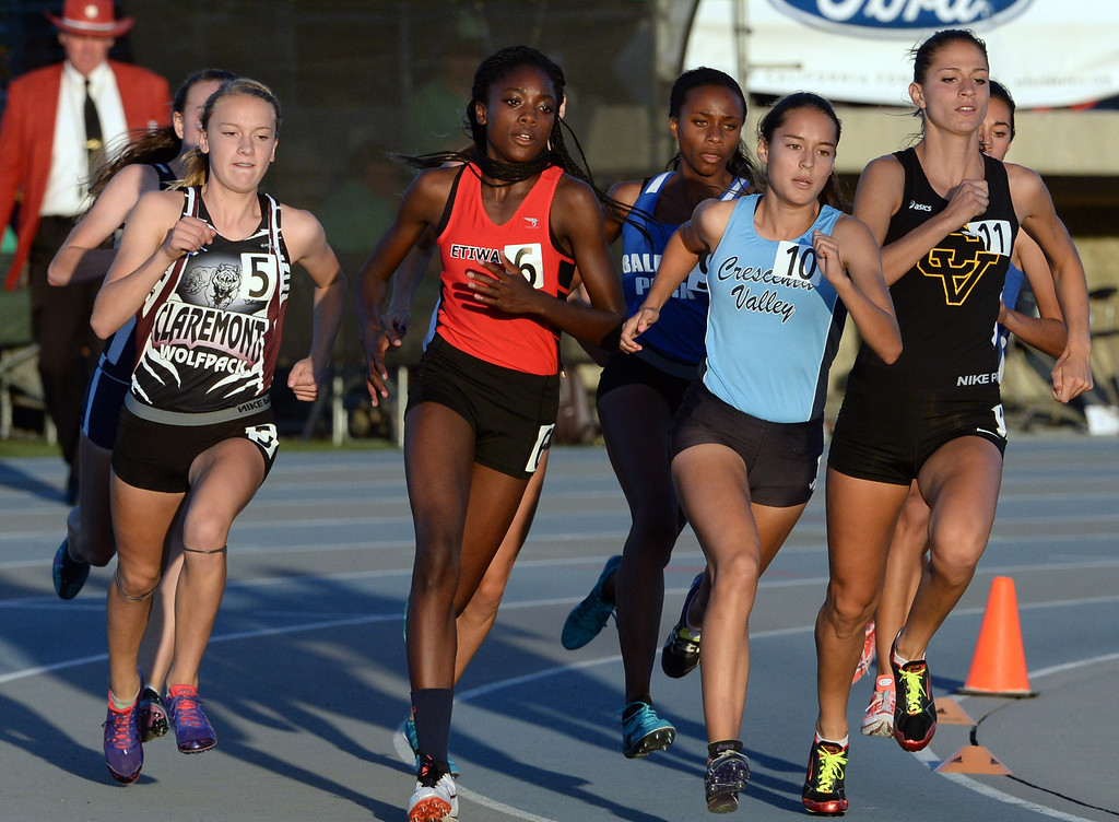 . Claremont\'s Annie Boos (5) along with Etiwanda\'s Jacquelyn Hill (6), Crescenta Valley\'s Megan Melnyk and Baldwin Park\'s Susie Garza, fourth from right, competes in the 800 meter run during the CIF-SS Masters Track and Field meet at Falcon Field on the campus of Cerritos College in Norwalk, Calif., on Friday, May 30, 2014.   (Keith Birmingham/Pasadena Star-News)