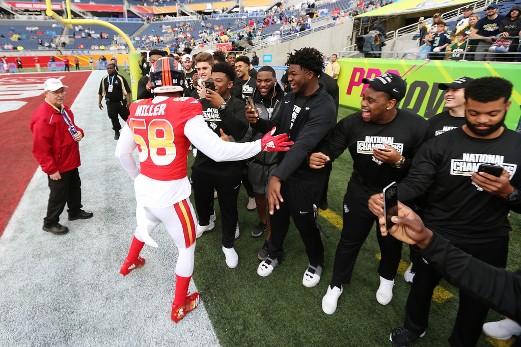 . AFC linebacker Von Miller, of the Denver Broncos, greets the UFC football team prior to the NFL Pro Bowl football game at Camping World Stadium, Sunday, Jan. 28, 2018, in Orlando, Fla. (AP Photo/Doug Benc)
