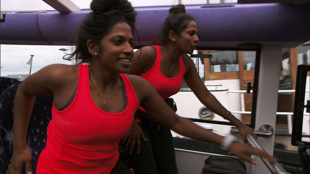 ". ""Fishy Kiss (Amsterdam, Netherlands)\""--In an attempt to get the Fast Forward, Twins Natalie (left) and Nadiya (right) must ride on The Floating Dutchman and eat ten herring before it reaches land on THE AMAZING RACE on the CBS Television Network. Photo: CBS ©2012 CBS Broadcasting, Inc. All Rights Reserved"