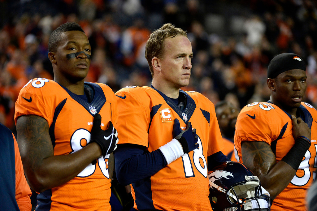 . Denver Broncos quarterback Peyton Manning (18) with wide receiver Demaryius Thomas (88) and tight end Virgil Green (85)  during the National Anthem at the start of the game. The Denver Broncos vs. the San Diego Chargers at Sports Authority Field at Mile High in Denver on December 12, 2013. (Photo by John Leyba/The Denver Post)