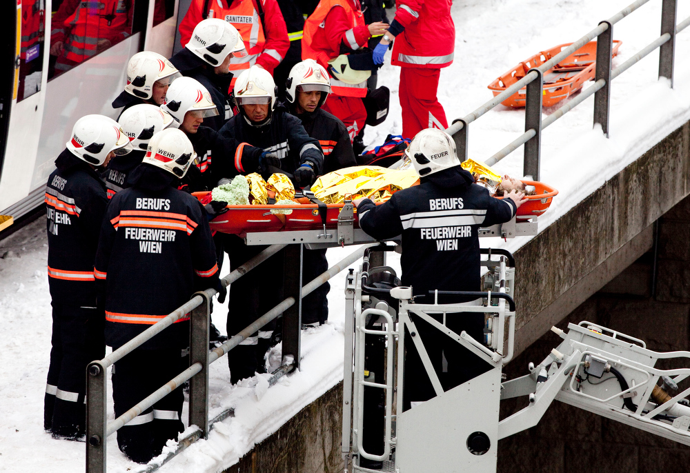 Description of . Firefighters rescue an injured passenger at the site where two trains of the line S45 crashed on January 21, 2013 in Vienna, Austria AFP PHOTO / DIETER NAGLDIETER NAGL/AFP/Getty Images