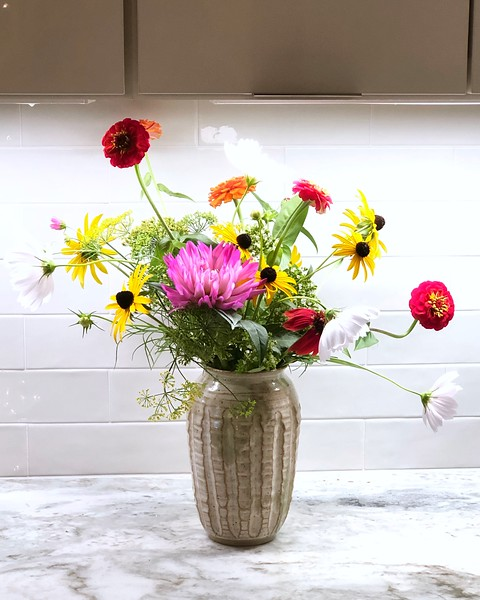 After kitchen with flowers from Lowell community garden.jpg