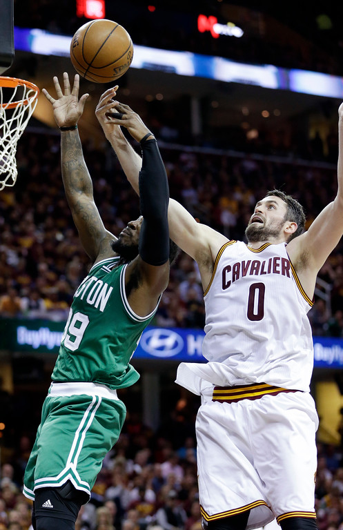 . Cleveland Cavaliers\' Kevin Love (0) and Boston Celtics\' Jae Crowder (99) battle for a rebound during the first half of Game 4 of the NBA basketball Eastern Conference finals, Tuesday, May 23, 2017, in Cleveland. (AP Photo/Tony Dejak)