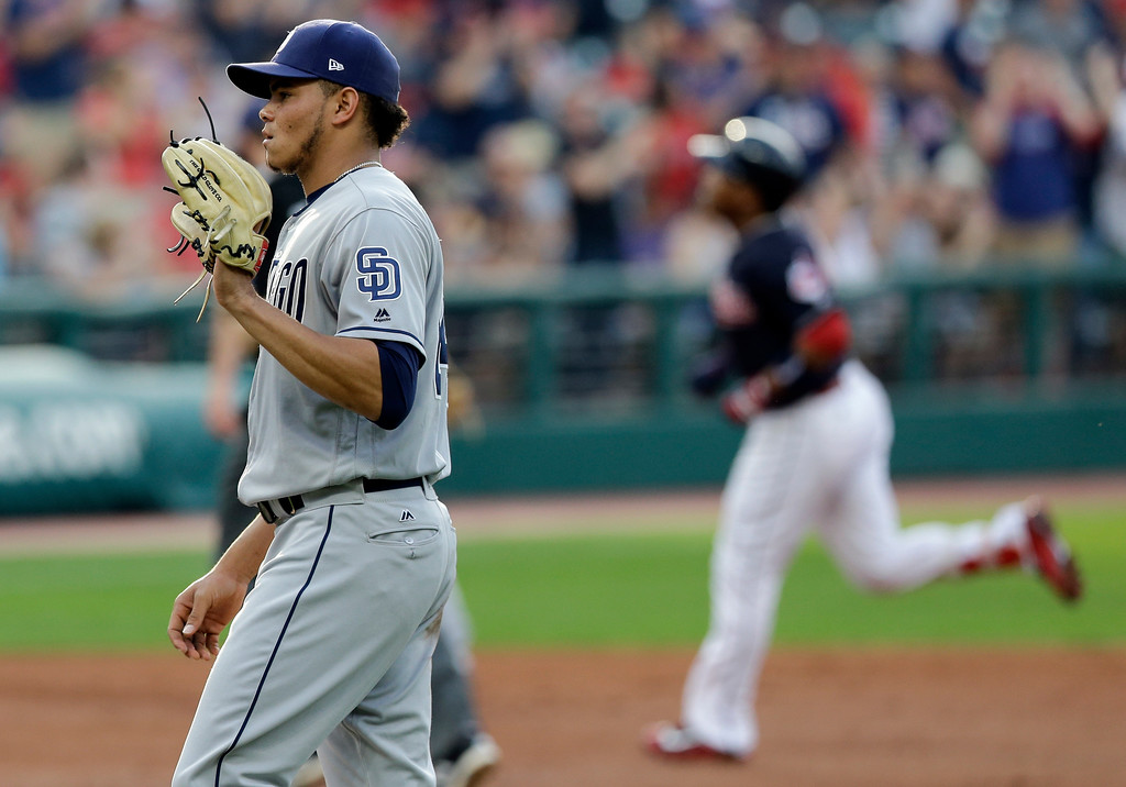 . San Diego Padres starting pitcher Dinelson Lamet waits for Cleveland Indians\' Jose Ramirez to run the bases after Ramirez hit a two-run home run in the first inning of a baseball game, Thursday, July 6, 2017, in Cleveland. Michael Brantley scored on the play. (AP Photo/Tony Dejak)