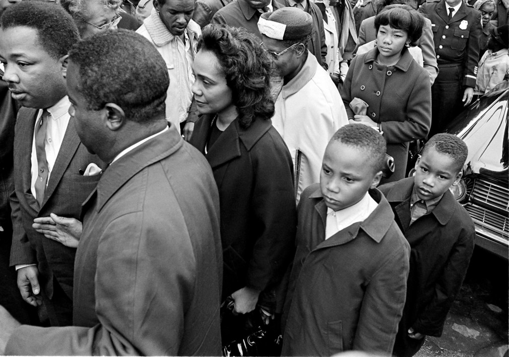 . Family members and friends of the assassinated civil rights leader Dr. Martin Luther King Jr., follow his casket into an Atlanta funeral home after the body arrived from Memphis, on April 5, 1968. From left are: King\'s brother, the Rev. A.D. Williams King; Dr. Ralph Abernathy, King\'s close associate and new head of the SCLC, Coretta Scott King, the widow, and her two sons, Martin Luther III, 10,  and Dexter, 7.  (AP Photo/Bill hudson)