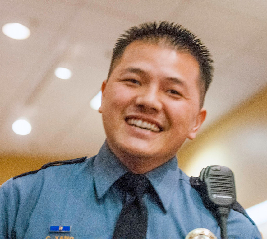 ". Officer Chou ""Jim\"" Yang smiles after he and his partner, Officer Yileng Vang, were honored as runners-up for Detectives of the Year. (Pioneer Press: Chris Polydoroff)"