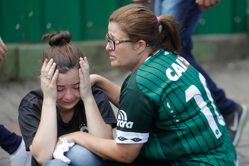 . Fans of Brazil\'s soccer team Chapecoense mourn outside the Arena Conda stadium in Chapeco, Brazil, Tuesday, Nov. 29, 2016. A chartered plane that was carrying the Brazilian soccer team to the biggest match of its history crashed into a Colombian hillside and broke into pieces, killing 75 people and leaving six survivors, Colombian officials said Tuesday. (AP Photo/Andre Penner)