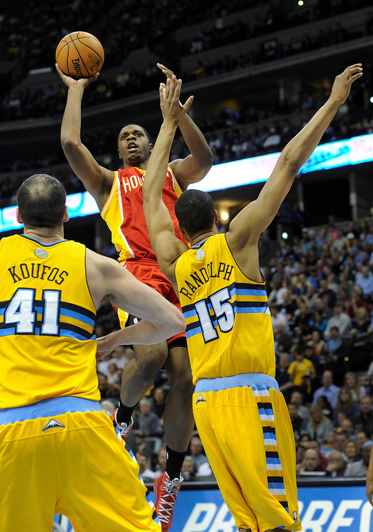 . DENVER, CO. - APRIL 6: Terrence Jones (6) of the Houston Rockets lifted a shot over Kosta Koufos (41) and Anthony Randolph (15) of the Denver Nuggets in the first half. The Denver Nuggets hosted the Houston Rockets at the Pepsi Center Saturday night, April 6, 2013. Photo By Karl Gehring/The Denver Post)
