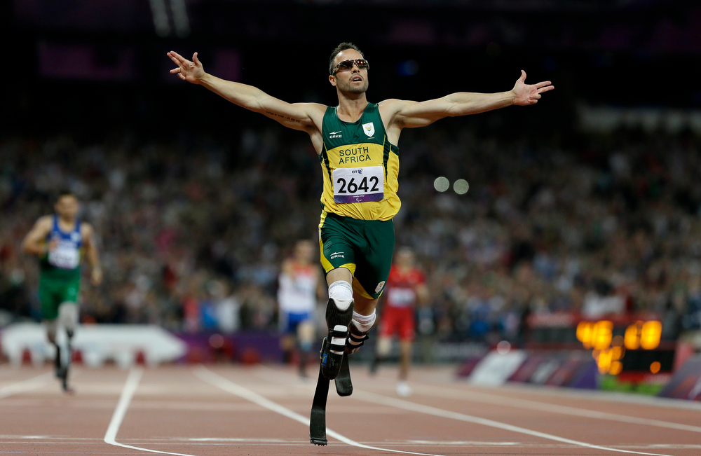 Description of . In this Saturday, Sept. 8, 2012 file photo, South Africa's Oscar Pistorius wins gold in the men's 400-meter T44 final at the 2012 Paralympics, in London. Pistorius has been arrested after a 30-year-old woman was shot dead at his home in South Africa, early Thursday, Feb. 14, 2013. (AP Photo/Kirsty Wigglesworth, File)