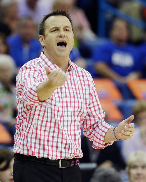 . Louisville head coach Jeff Walz directs his team in the first half of a national semifinal at the Women\'s Final Four of the NCAA college basketball tournament against California, Sunday, April 7, 2013, in New Orleans. (AP Photo/Dave Martin)