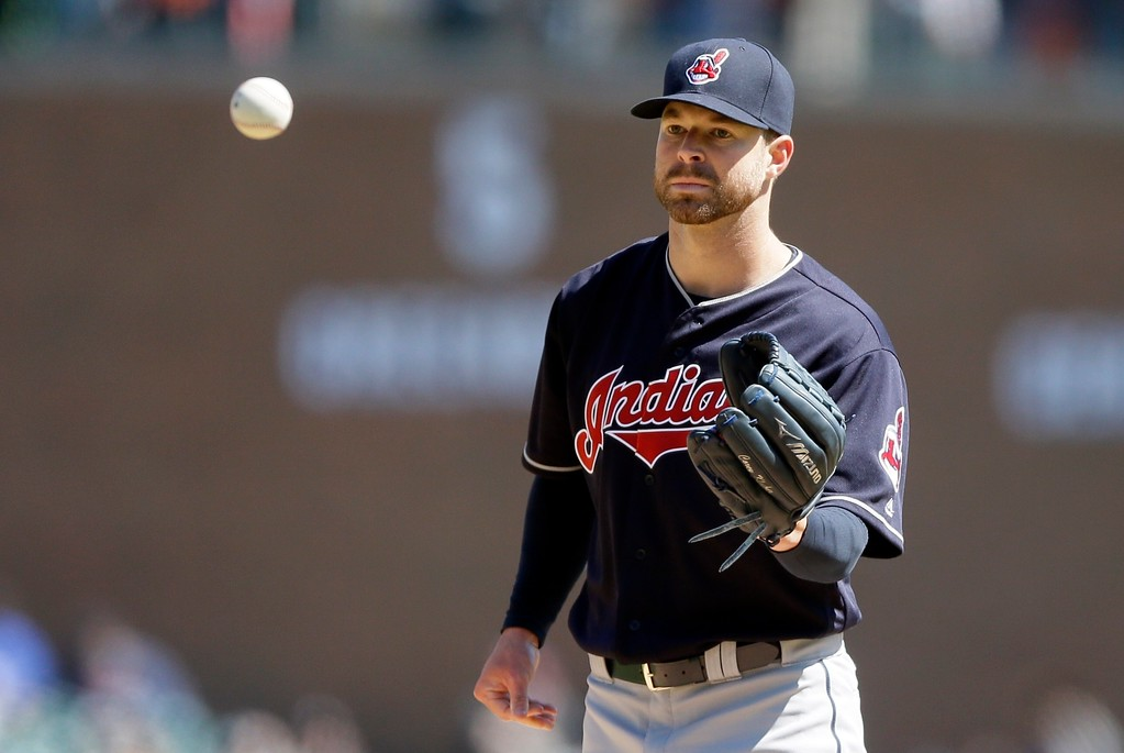 . Cleveland Indians starting pitcher Corey Kluber waits on a ball during the seventh inning of a baseball game against the Detroit Tigers, Saturday, April 23, 2016, in Detroit. Kluber struck out 10 over eight innings and the Indians routed the Tigers 10-1 for Kluber\'s first win of the season. (AP Photo/Carlos Osorio)
