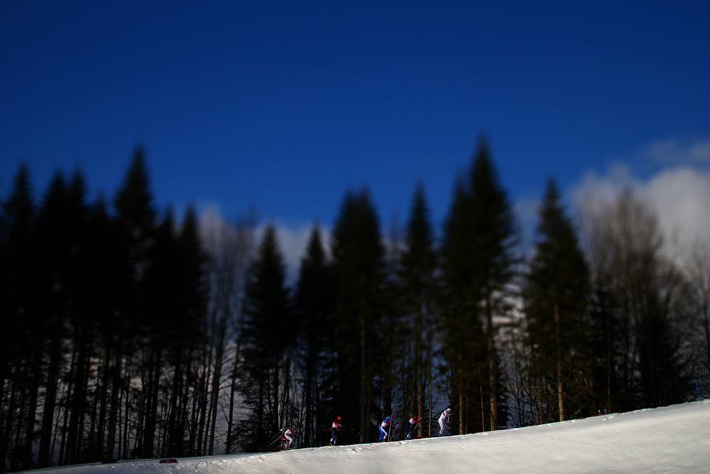 . (EDITORS NOTE: A TILT AND SHIFT LENS WAS USED IN THE CREATION OF THIS IMAGE) Skiers compete in Finals of the Men\'s Sprint Free during day four of the Sochi 2014 Winter Olympics at Laura Cross-country Ski & Biathlon Center on February 11, 2014 in Sochi, Russia.  (Photo by Doug Pensinger/Getty Images)