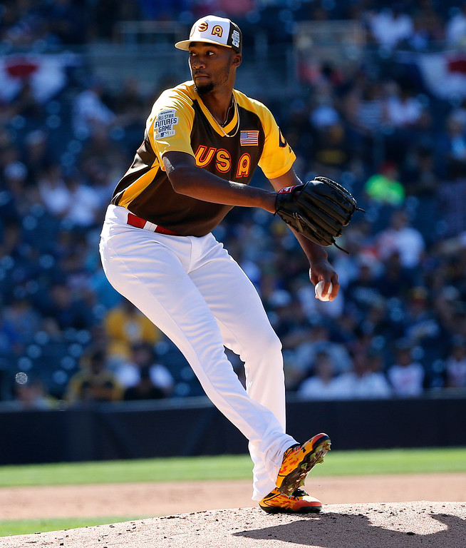 . U.S. Team pitcher Amir Garrett, of the Cincinatti Reds, throws against the World Team during the second inning of the All-Star Futures baseball game, Sunday, July 10, 2016, in San Diego. (AP Photo/Lenny Ignelzi)