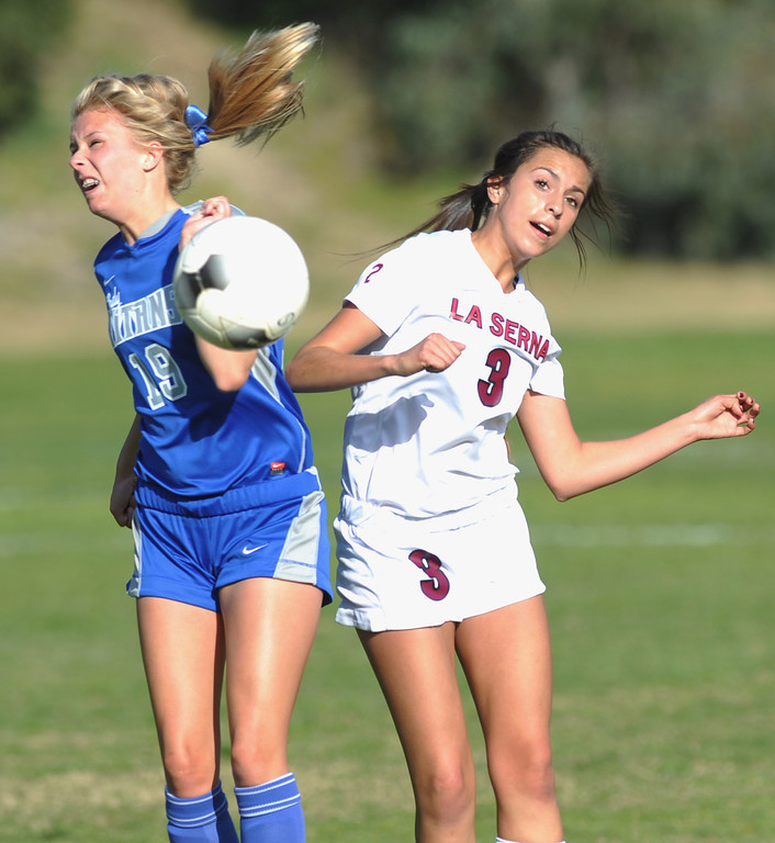 . La Serna\'s Miranda Yzabal (#3) collides with Temescal Canyon\'s Sydnee Platner (#19) in their CIF-SS girls soccer Division 5 quarterfinal game at La Serna High School in Whittier on Thursday February 21, 2013. La Serna beat Temescal Canyon 2-0. (SGVN/Staff Photo by Keith Durflinger)
