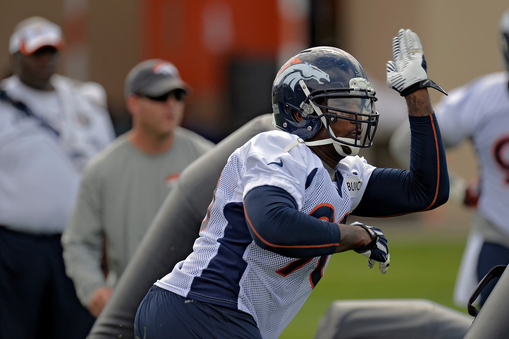 . Denver Broncos outside linebacker Shaun Phillips (90) runs through drills during practice August 23, 2013 at Dove Valley (Photo by John Leyba/The Denver Post)