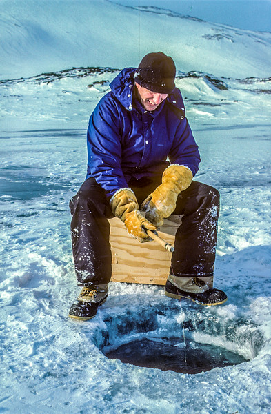 John Klein ice fishing in Cape Dorset, Baffin Island 1987
