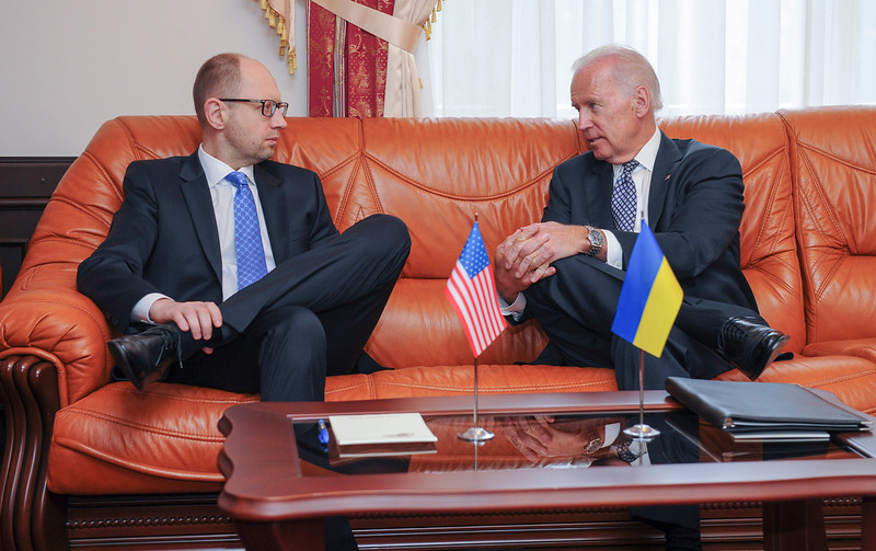 ". U.S. Vice President  Joe Biden, right, talks with Ukrainian Prime Minister Arseniy Yatsenyuk during a meeting in Kiev, Ukraine, Tuesday, April. 22, 2014. Biden called on Moscow to encourage pro-Russia separatists in eastern Ukraine to vacate government buildings and checkpoints, accept amnesty and ""address their grievances politically.\"" (AP Photo/Andrew Kravchenko, Pool)"