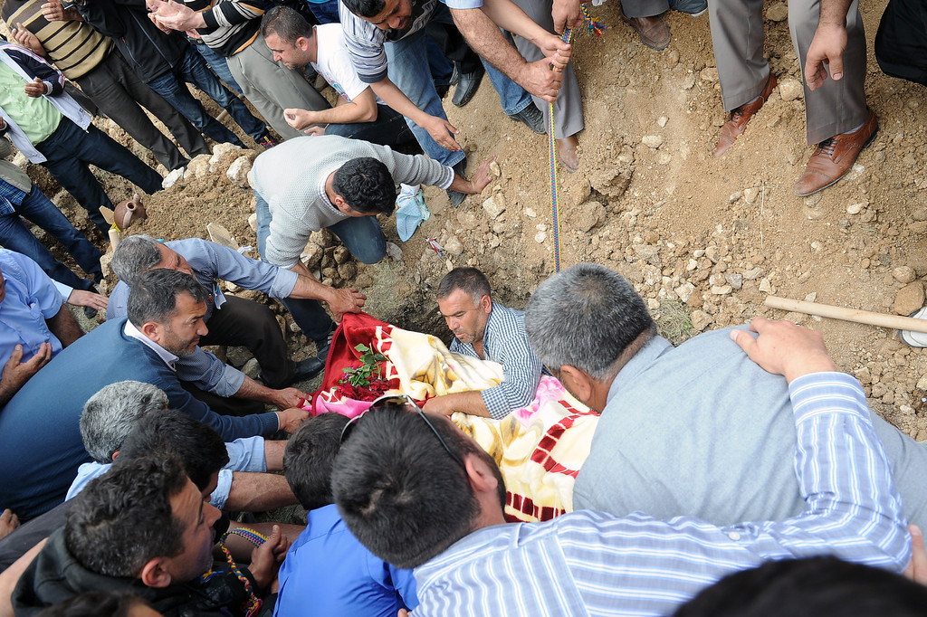 . People burry a mine accident victim in Soma, Turkey, Thursday, May 15, 2014. An explosion and fire at a coal mine in Soma, some 250 kilometers (155 miles) south of Istanbul, killed hundreds of workers, authorities said, in one of the worst mining disasters in Turkish history.(AP Photo/Emre Tazegul)