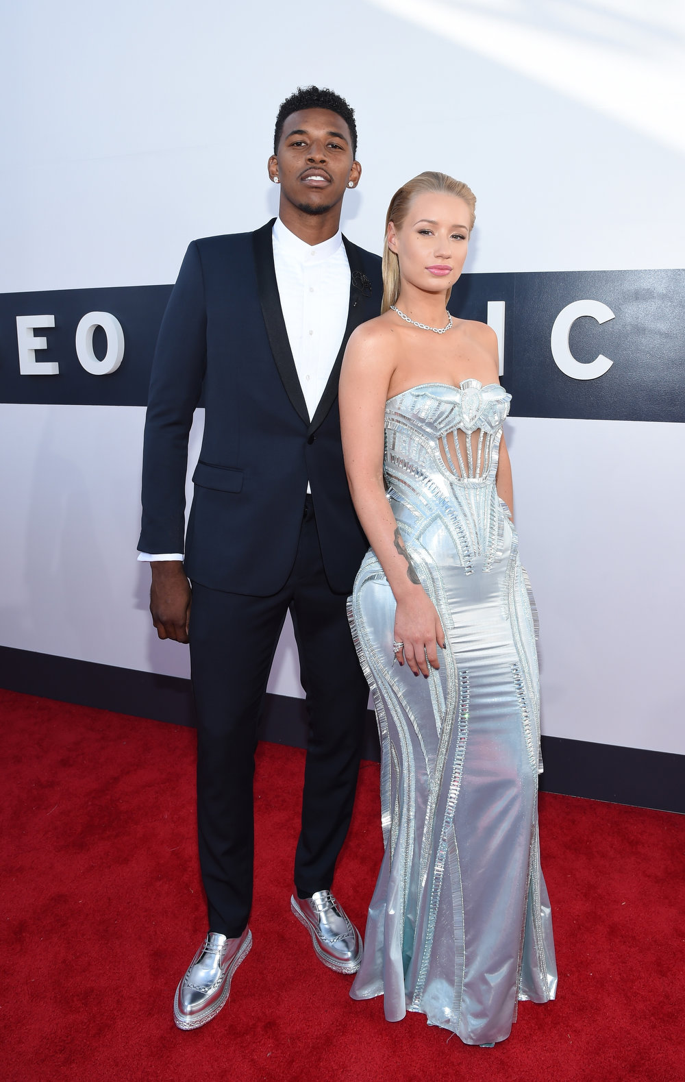 . Basketball player Nick Young (L) and rapper Iggy Azalea attend the 2014 MTV Video Music Awards at The Forum on August 24, 2014 in Inglewood, California.  (Photo by Larry Busacca/Getty Images for MTV)