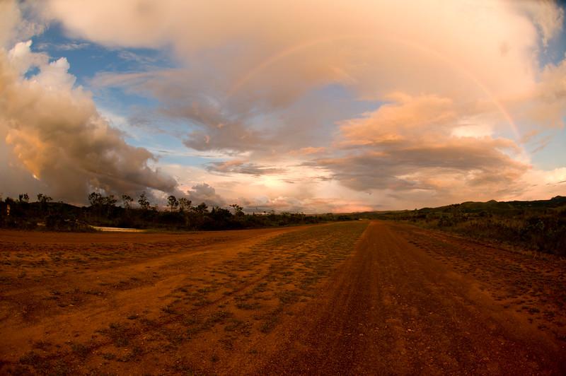 Full rainbow over a road in  El Pauji community in the Gran Sabana, Santa Elena de Uairen, Venezuela.
