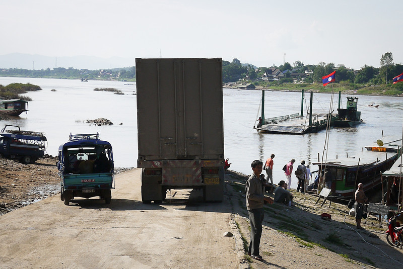 "A huge semi waits to cross over the Mekong River into Thailand"" alt=""semi crossing mekong"