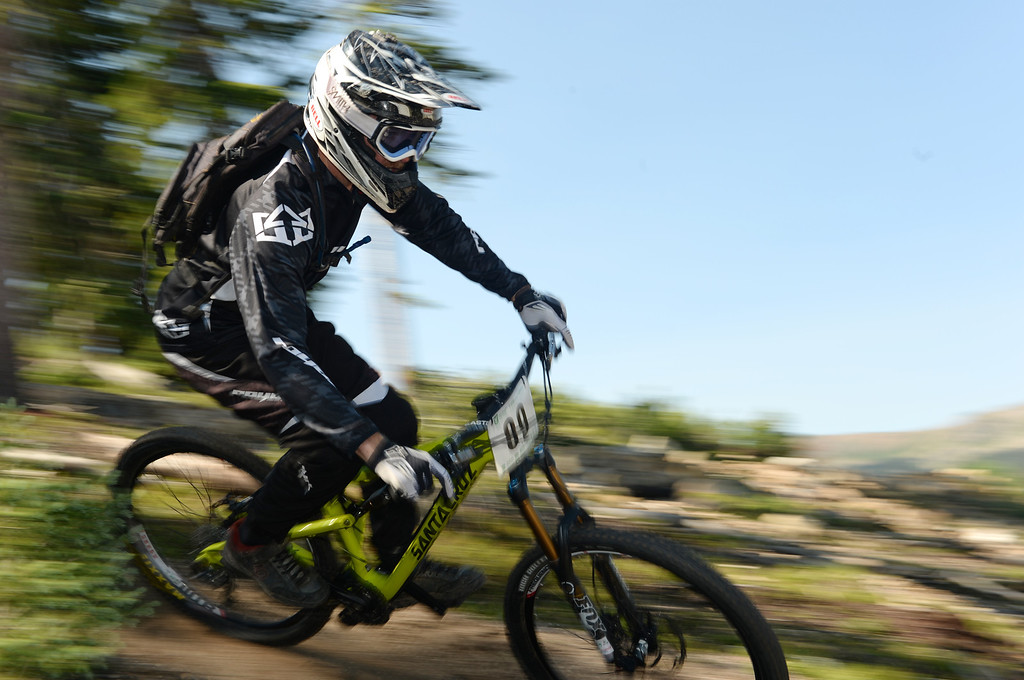 . WINTER PARK, CO. - July 26: Evan Turpen controls the bike during the first stage of First international Enduro World Cup Championship ever in U.S. at Winter Park, Colorado. July 26, 2013. (Photo By Hyoung Chang/The Denver Post)