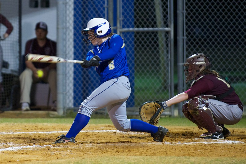 Menendez's Samantha Sincavage (#6) hits a home run in the 5th quarter, bringing the score to 8-0, at Friday's softball game against St Augustine High School.