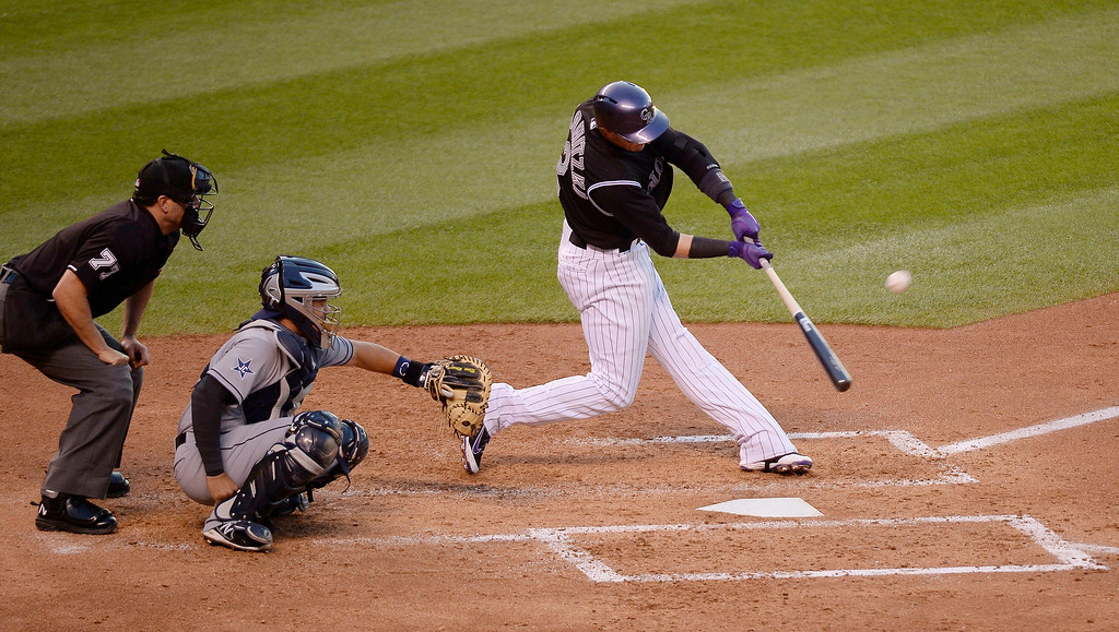 . Colorado Rockies shortstop Troy Tulowitzki (2) flies out to San Diego Padres right fielder Chris Denorfia (13) for the first out during the fourth inning July 8, 2014 at Coors Field. (Photo by John Leyba/The Denver Post)