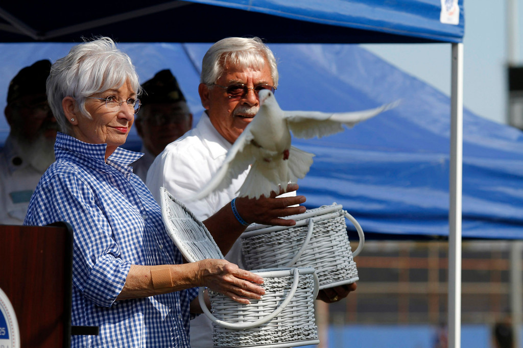 ". Bobolene Pope, left, and Edward Molina, release doves during the Vietnam Veterans Memorial ""The Wall That Heals\"" Closing Ceremony event, at La Habra High School, in La Habra, Sunday, July 14, 2013. (SGVN/Correspondent Photo by James Carbone)"
