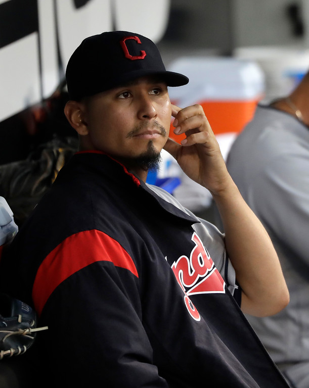 . Cleveland Indians starting pitcher Carlos Carrasco sits in the dugout during the second inning of a baseball game against the Chicago White Sox Monday, June 11, 2018, in Chicago. (AP Photo/Charles Rex Arbogast)