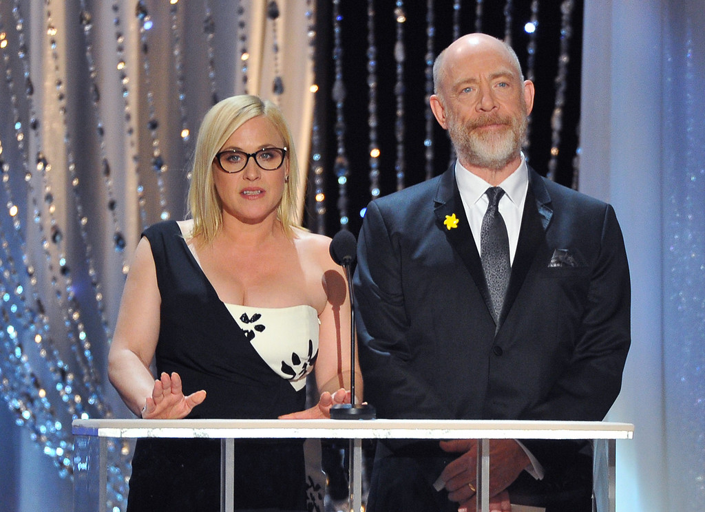 . Patricia Arquette, left, and J.K. Simmons present the award for outstanding ensemble in a comedy series at the 22nd annual Screen Actors Guild Awards at the Shrine Auditorium & Expo Hall on Saturday, Jan. 30, 2016, in Los Angeles. (Photo by Vince Bucci/Invision/AP)