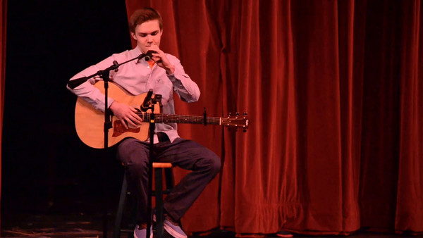 Ryan singing at Green & White Revue 2015