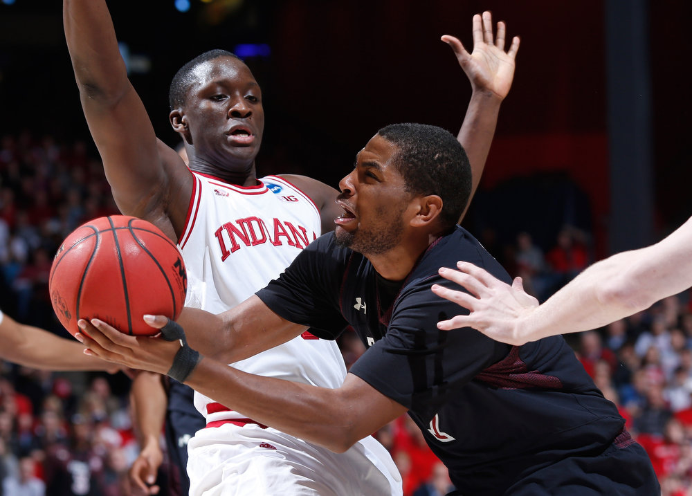 . Khalif Wyatt #1 of the Temple Owls drives with the ball against Victor Oladipo #4 of the Indiana Hoosiers in the first half during the third round of the 2013 NCAA Men\'s Basketball Tournament at UD Arena on March 24, 2013 in Dayton, Ohio.  (Photo by Joe Robbins/Getty Images)