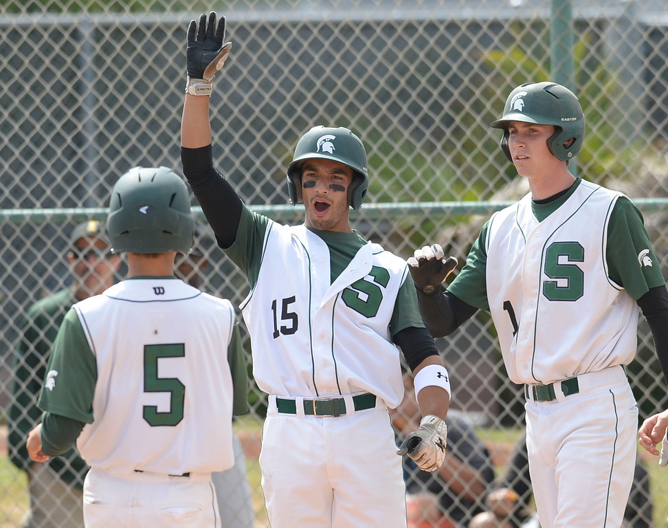 . South\'s Mike Esparza (15) and Gunner Johnson (1) celebrate as Perry Richmond (5) crosses home against Estancia in a first-round CIF SS Division IV baseball game Friday in Torrance. South won 7-2. 20130517 Photo by Steve McCrank / Staff Photographer