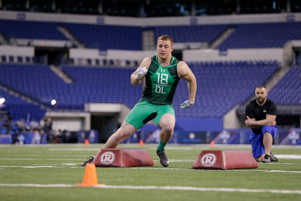 . North Dakota State defensive lineman Kyle Emanuel runs a drill at the NFL football scouting combine in Indianapolis, Sunday, Feb. 22, 2015. (AP Photo/David J. Phillip)