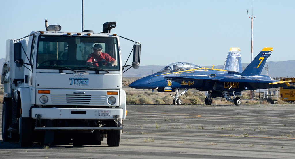 . March 19,2014. Lancaster CA. Last minute runway sweeping is done as the US Navy Blue Angels arrive at Fox field Wednesday morning. The Los Angels County air show with the Blue Angels will happen this Friday and Saturday at Fox Field.  Photo   by Gene Blevins/LA DailyNews