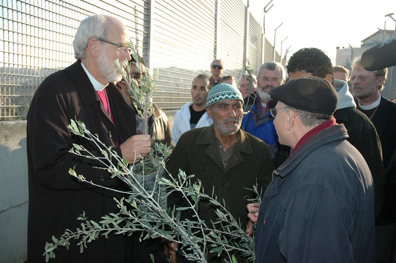 ELCA Presiding Bishop Mark Hanson, left, listens in as ELCJHL Bishop Munib Younan, right, speaks to Sabri Ghrael Abu Sameer at his home in Beddo, West Bank, Jan. 12.