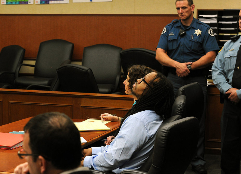. Nathan Dunlap, looks toward the ceiling during the proceedings. A hearing was held today to set a date for the execution of convicted murderer Nathan Dunlap at the Arapahoe County Court in Division court room 408  in Centennial, CO on May 1, 2013.   Judge William Sylvester is the presiding judge on the case.  (Photo by Helen H. Richardson/The Denver Post)