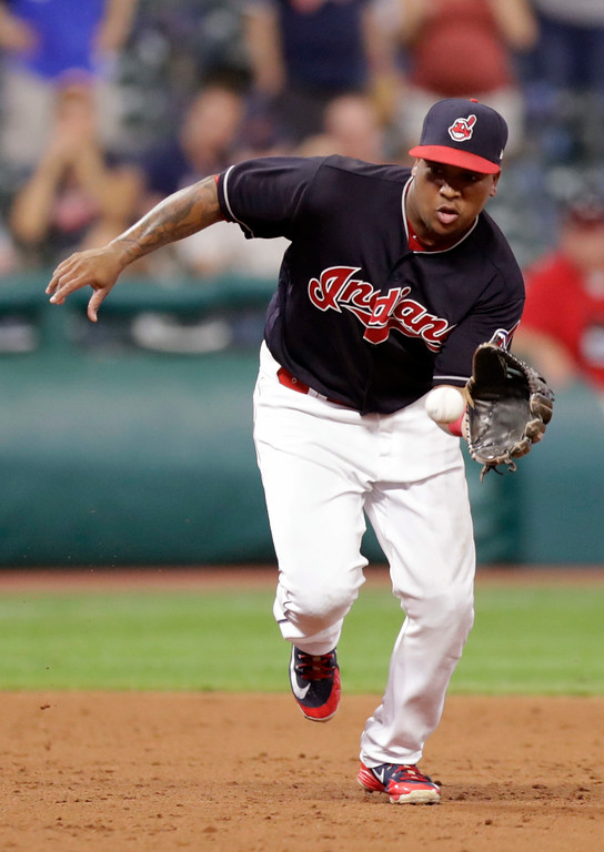 . Cleveland Indians\' Jose Ramirez fields a ball hit by Minnesota Twins\' Williams Astudillo in the ninth inning of a baseball game, Tuesday, Aug. 28, 2018, in Cleveland. The Indians won 8-1. (AP Photo/Tony Dejak)