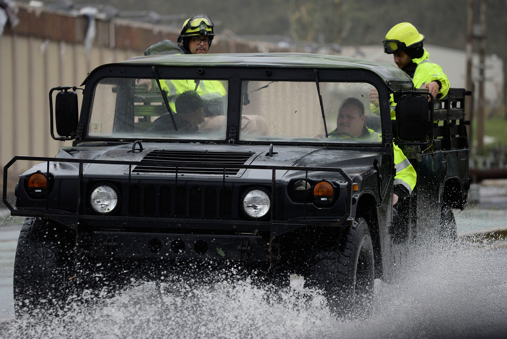. Rescue personnel from the Emergency Management Agency drive through a flooded road after Hurricane Maria hit the eastern region of the island, in Humacao, Puerto Rico, Tuesday, September 20, 2017. The strongest hurricane to hit Puerto Rico in more than 80 years destroyed hundreds of homes, knocked out power across the entire island and turned some streets into raging rivers in an onslaught that could plunge the U.S. territory deeper into financial crisis. (AP Photo/Carlos Giusti)